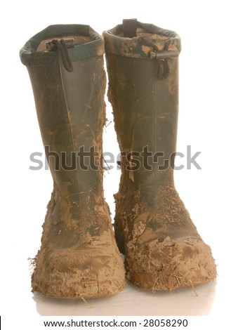 muddy rubber boots isolated on white background - stock photo