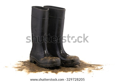 Muddy rubber boots 3/4 view isolated on white background - stock photo