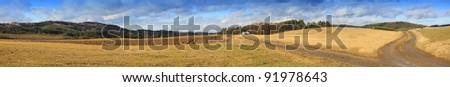 muddy rural road, autumn landscape, crossroads, Czech Republic, panorama - stock photo