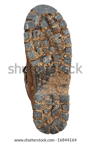 Muddy sole of a hiking boot, isolated on white. - stock photo