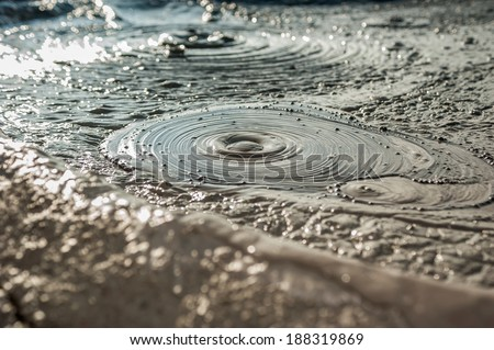 Muddy Volcanoes,Buzau,Romania (unique geological phenomenon in Europe where the earth gas reaches the surface through hills making small Mud volcanoes) - stock photo