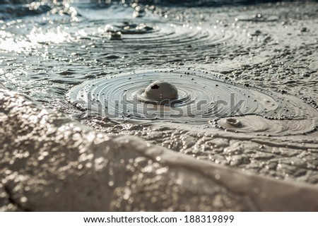 Muddy Volcanoes closeup. Buzau,Romania (unique geological phenomenon in Europe where the earth gas reaches the surface through hills making small Mud volcanoes) - stock photo