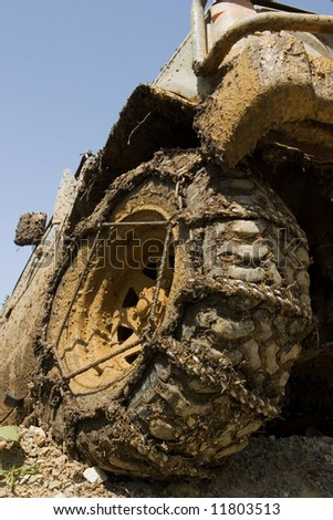 Muddy wheel close-up on a vehicle participating in off-road challenge - stock photo
