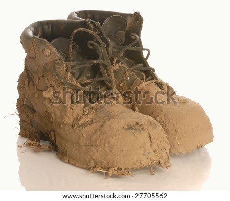 muddy work boot isolated on a white background - stock photo