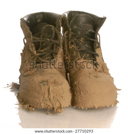 muddy work boots isolated on a white background - stock photo