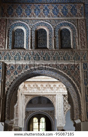 Mudejar arches from the Patio de las Munecas (Wrists court) in the Royal Alcazar of Sevilla, Spain. UNESCO World Heritage Site - stock photo