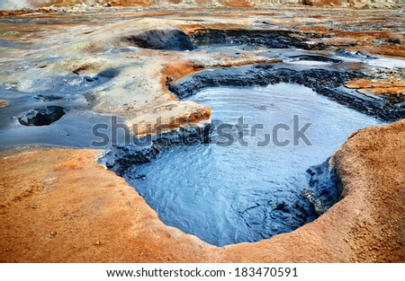 Mudpots in the geothermal area Hverir, Iceland. - stock photo