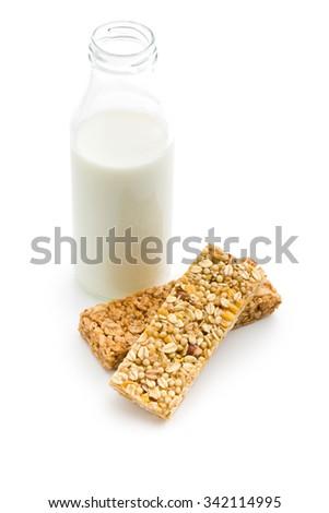 muesli bar and milk in glass bottle - stock photo