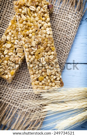 Muesli bars, cereal bars on the wooden background. - stock photo
