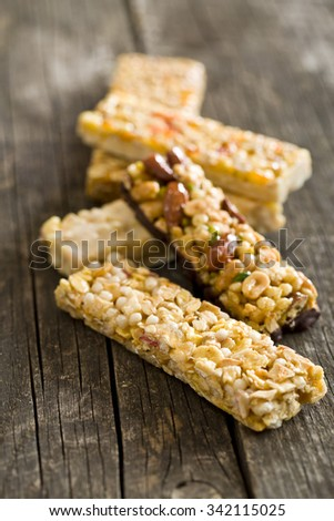 muesli bars on old wooden table - stock photo