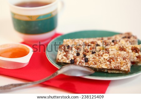 muesli bars on the tea cup background - stock photo