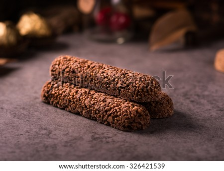 Muesli Bars with Chocolate on wooden background - stock photo