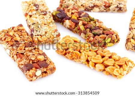 Muesli bars with different nuts isolated on white background. - stock photo
