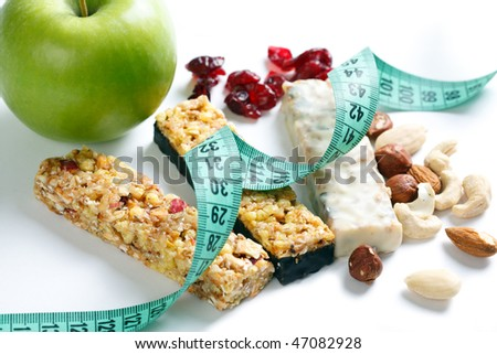 muesli bars with measuring tape - stock photo