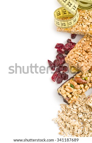 muesli bars with raisins and oat flakes on white background - stock photo