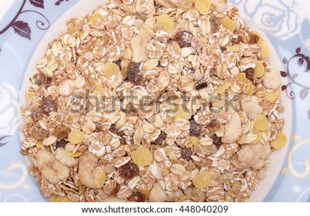muesli delight breakfast cereal dried fruits and wheat flakes food contains sultanas banana pear apricot apple plum whole wheat oats barley and other rice grains good for health and diet person - stock photo