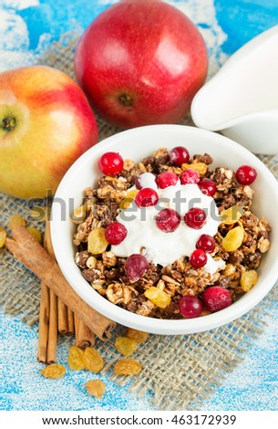 Muesli for breakfast, fresh apples with cinnamon and cream