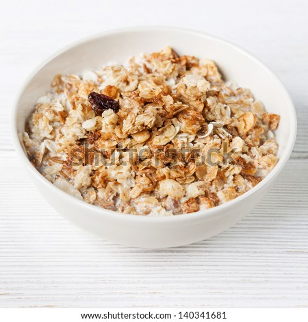 Muesli granola with raisin in wooden bowl - stock photo