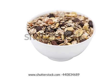 muesli in a white chinaware bowl - stock photo