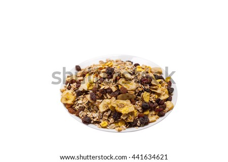 muesli in a white chinaware plate - stock photo
