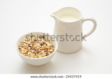 Muesli in and jug with milk