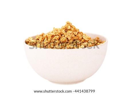 Muesli in bamboo bowl isolated on white background. - stock photo