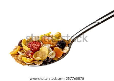 Muesli in spoon on white banckground including clipping path - stock photo