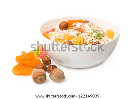 muesli with dried fruit and nuts isolated on white - stock photo