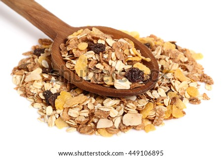 Muesli with dried fruits on wooden spoon. Isolated on white background.