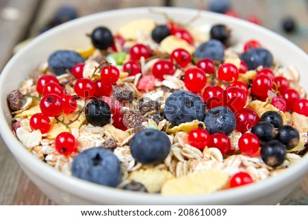 muesli with fresh berries on wooden background. healthy Breakfast