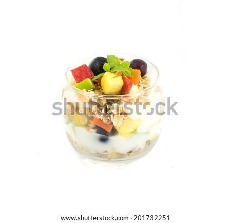 Muesli with fresh fruits and yogurt isolate on white background - stock photo