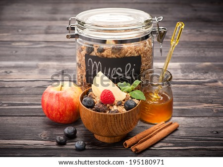 Muesli with honey, berries and fruits. healthy Breakfast - stock photo