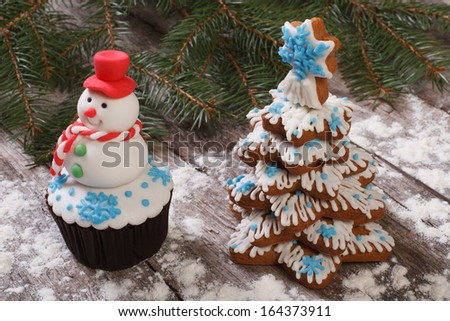 muffin as a snowman and Christmas Tree Cookies - stock photo