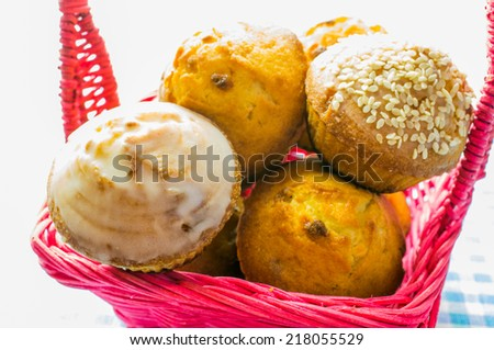 Muffin, cake, Cupcake in a pink wicker basket. - stock photo