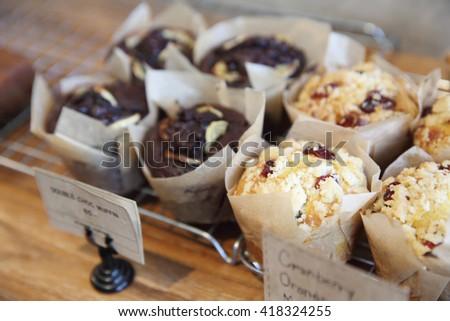 muffin cake on wood background - stock photo