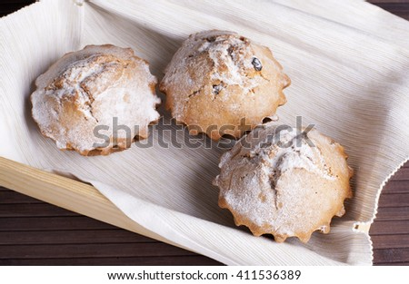 Muffin cakes on a white tablecloth.
