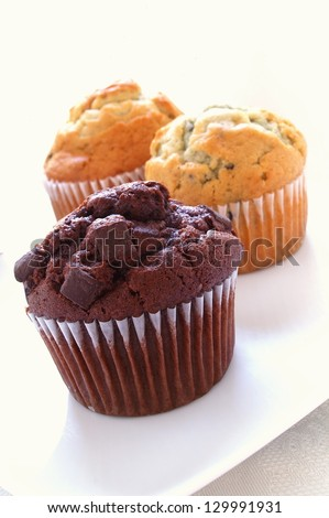 Muffin selection on white - stock photo