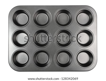 Muffin Tray. Isolated with clipping path. - stock photo