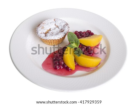 Muffin with canned peach and berries. Isolated on a white background.