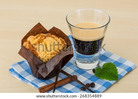 Muffin with espresso coffee served on napkin - stock photo