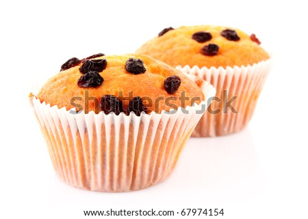 Muffin with raisins isolated on white - stock photo