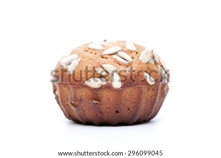 Muffin with  sunflower seeds isolated on a white background