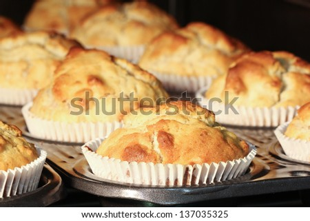 Muffins being baked in the oven (V-format: ID189963278) - stock photo