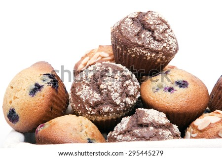 Muffins in basket isolated on a white background - stock photo