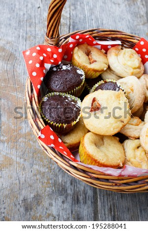 Muffins in picnic basket - stock photo