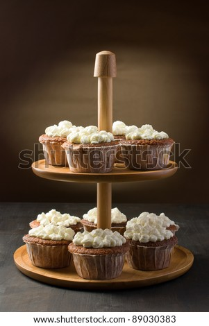 Muffins on a cake stand arrangement - stock photo