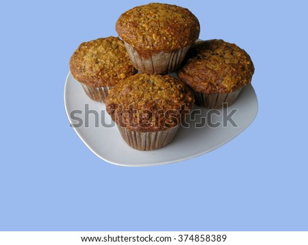 Muffins on blue - stock photo