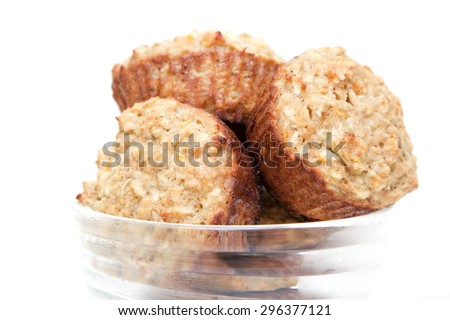 Muffins with apple & carrots isolated on a white background  - stock photo