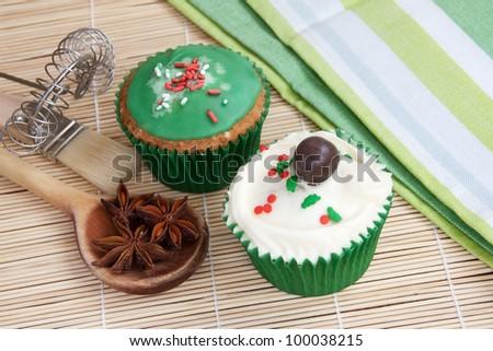 Muffins with baking utensils - stock photo