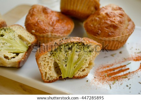 Muffins with broccoli on a white plate on a wooden background   - stock photo
